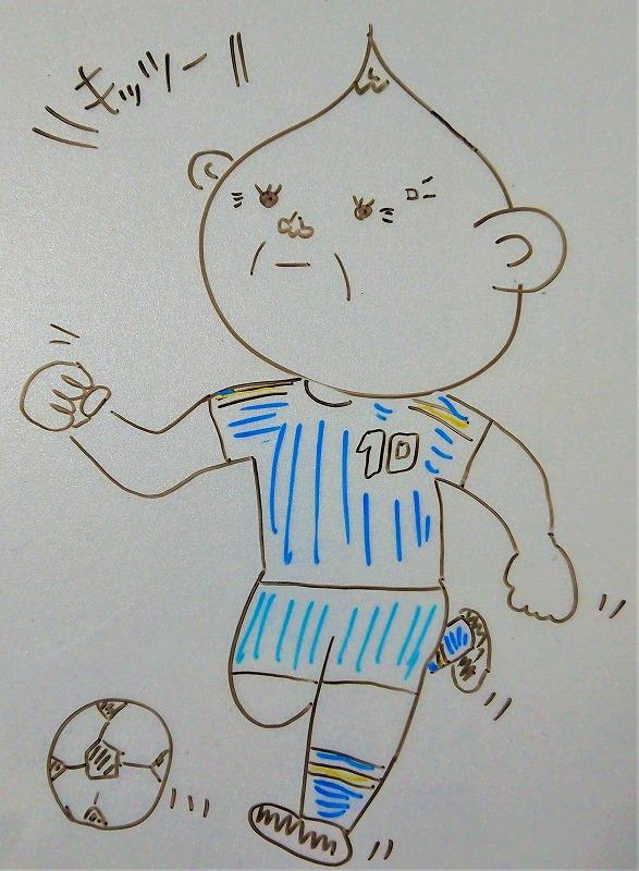 サッカーをするおじさん